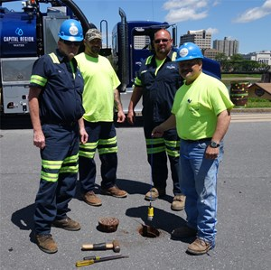 540 Technologies and Capital Region Water workers posing over open water pipe